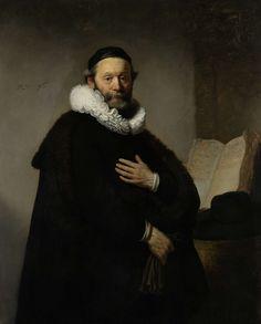 Rembrandt Harmensz. van Rijn | Portrait of Johannes Wtenbogaert, Rembrandt Harmensz. van Rijn, 1633 | Portret van Johannes Wtenbogaert (1557-1644), Remonstrants predikant, op 76-jarige leeftijd. Staande, ten halven lijve, handschoenen in de rechterhand, de linkerhand op de borst. Rechts tegen de muur staat een opengeslagen boek, ervoor ligt een zwarte hoed met een brede rand.