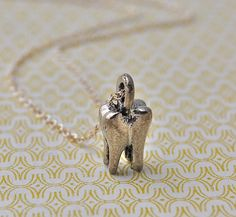 The Tiniest Molar Tooth Necklace by verabel on Etsy, $22.00
