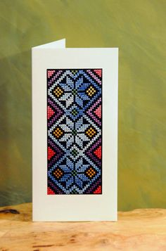 """Palestinian Embroidered Greeting Card    This lovely pattern has been cross stitch embroidered in very fine stitches with DMC Pearl Cotton (multicolor, blue). It has been glued in a triple card so it can be used as a greeting card.    (17.50x11.40 cm; 6.89x4.49 """")"""