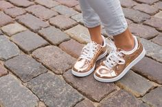 From silver flats to flashy gold stilettos, metallic shoes add ultimate glamour to any outfit. Unfortunately, the metallic finish can easily get scuffed up. Here's how to touch up your shoes shoes and restore them to their former shining glory.