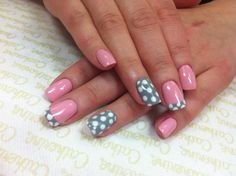 Pink with a grey and white polk-a-dot accent nail.