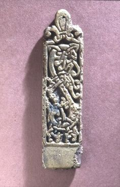 Cast rectangular copper alloy plaque with foliate animal ornament in relief.  Viking, 11th c.  Found in the Thames river-bed, London.  Length 10.6 cm.  British Museum.