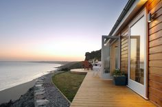 An eco-friendly luxury cliff top hideaway! This Cornish self-catering beach hut has stunning coastal vistas over Whitsand Bay and beyond. The Edge, a small beach cottage in Cornwall, England.