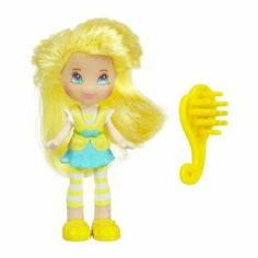 "Strawberry Shortcake Hasbro Mini Doll in Purse Lemon Meringue by Hasbro. $5.99. includes hair brush. ages 4+ year. Strawberry Shortcake & Friends Lemon Meringue with Mini purse. Warning: Choking Hazard - Small Parts. Not for children under 3 years. Get ready for some absolutely ""delicious"" fun! Your super-pretty and sweet-smelling Lemon Meringue figure is already dressed in a ""berry"" adorable outfit, but now she needs you to style her hair with her brush accessory...."