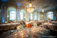 Biltmore Ballrooms wedding reception decor orange and blue  Ceremony/Reception Venue – The Biltmore Ballrooms Wedding Planner- Lemiga Events Pillows - I Do Linen, www.idolinens.com Lighting- Unique Event Management Drapery- Event Drapery