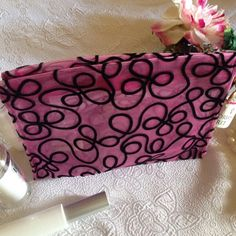 """Victoria's Secret cosmetic bag NWT Black/pink Gorgeous Victoria's Secret zip top cosmetic bag perfect for holding all your essentials.  Semi transparent with plastic lining. Beautiful fuchsia glittery sheer material with a velvety black scroll design. Complete with Victoria's Secret heart zipper pull. Size is approximately 7"""" w X 6"""" h X 2.5"""" deep.  New with tags, never used, from smoke free home. Looks great with black crushed velvet VS bag also in my closet. Victoria's Secret Bags Cosmetic…"""
