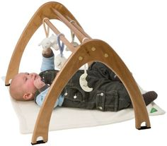 Wood Baby Gyms. This could totally be a DIY project. Very cool.