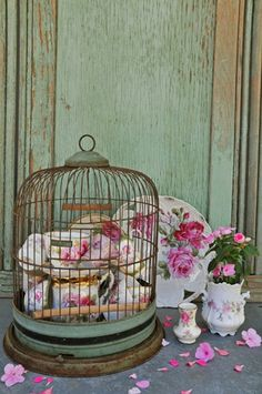 tea cups and bird cage - twist on the usual glass cloche