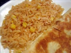 Tex-mex Rice from Food.com: This is a version of rice that you find at a Tex-Mex restaurant. It is way easier than it looks and after you have made it once or twice - you can do it by heart. My kids love it and I love that I can sneak a few veggies in! Can be made vegan with veggie broth.