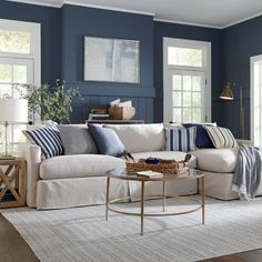 Get inspired by Coastal Living Room Design photo by Tobi Fairley Interior Design. Wayfair lets you find the designer products in the photo and get ideas from thousands of other Coastal Living Room Design photos. Blue Living Room Decor, Accent Walls In Living Room, Coastal Living Rooms, My Living Room, Living Room Designs, Blue And Cream Living Room, Modern Living Room Colors, Living Room Color Schemes, Living Room Trends