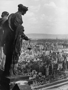 February 1945: High-angle view of the bombed remains of Dresden after Allied bombings, seen from the top of a tall building, possibly a courthouse, where a statue of a woman surveys the city while holding scales, Germany, World War II. (Photo by Hulton Archive/Getty Images)