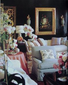 Mario Buatta room - Dramatic dark wall. Pastel furniture kind of throws me off, but, it's eye catching.