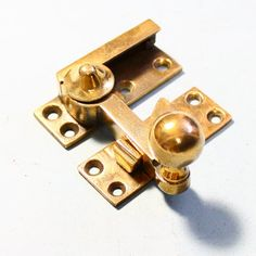 A solid cast bronze sash window catch wit a very strong spring, suitable for a large window. Sold
