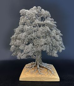 British artist Clive Maddison creates tree sculptures with nothing but single strands of wire that goes up from the roots to the intricate web of branches and l Sculpture Metal, Wire Tree Sculpture, Wire Sculptures, Metal Tree Wall Art, Metal Art, Tree Wall Decor, Art Decor, Colossal Art, Wire Trees