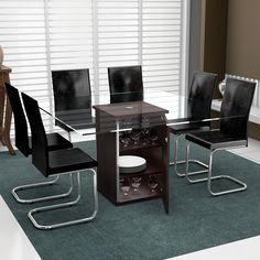 Preto combinado de vidro e metal garante uma decoração moderna e elegante. A base da mesa como armário oferece ainda mais praticidade.