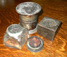 Three very old Tin Pounce Pots or Sanders c.1800's. The one in the front is showing the lid._Judith Walker's Collection