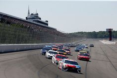Kyle Busch, driver of the #18 M&M's Red, White, & Blue Toyota, leads the field to turn one after taking the green flag to start the Monster Energy NASCAR Cup Series Axalta presents the Pocono 400 at Pocono Raceway on June 11, 2017 in Long Pond, Pennsylvania.