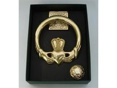 """Large Brass Claddagh Door Knocker-Ships Today by The Robert Emmet Co.. $79.95. This beautiful door knocker features a Claddagh symbol, as well as Celtic Knot accents. Made of Solid Brass, this two-piece door knocker measures approximately 5"""" across. Comes with its own mounting hardware and installation instructions. This lovely door knocker is the perfect finishing touch to any Irish home, and makes the perfect wedding or housewarming gift!"""