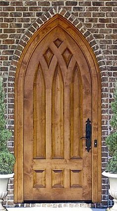 cathedral style door. The panels and carving are beautiful