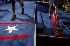 Workers clean the stage at Hofstra University on Sunday, September 25, 2016, in preparation for Monday's debate.