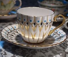 ROYAL CHELSEA GOLD WITH BLUE DOTS BONE CHINA TEA CUP AND SAUCER ENGLAND
