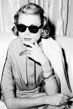 1956: American actress Grace Kelly being interviewed by journalists aboard the 'Constitution' before her wedding to Prince Rainier III of Monaco. ©Bob Harrow