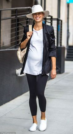 Fashionable: Although heading into maternity styles, the 31-year-old model looked amazing in her minimalist shirt-blazer combination