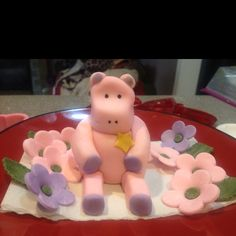 Hippo and flowers for baby shower cake. Made with gum paste and fondant.
