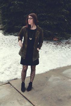 black dress + utility jacket + chevron necklace + dotted tights + sam edelman black petty boots