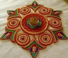 Find here Kundan Rangoli wholesaler & Wholesale Dealers in India. Get contact details & address of companies engaged in wholesale trade, manufacturing and supplying Kundan Rangoli across India. Diy Diwali Gifts, Diwali Craft, Thali Decoration Ideas, Diy Diwali Decorations, Peacock Rangoli, Flower Rangoli, Rangoli Ideas, Rangoli Designs Diwali, Craft Stick Crafts