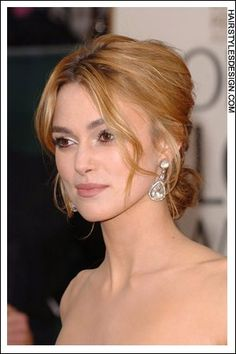 Details:  Hair Style: Keira Knightley has her long brown hair styled into an updo style. She has a center part with long bangs that curl nicely at the sides of the forehead. This look is fresh and romantic.  Hair Cut: Her haircut is long.  Hair Colour: Keira's hair colour is a nice light brown.  Suitable For:  Face shapes: oval, heart  Hair texture: thin, medium  Hair density: medium  Styling:  Techniques: blow dry  Products: mousse, hair spray, curl enhancer