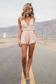Take a closer look at the Second Look Blush Pink Romper and you'll realize you can't live without it! Adjustable spaghetti straps support this breezy woven romper with a surplice front (with modesty snap) and gold grommet accents. Attached shorts flutter below an elasticized waist. Diagonal front pockets. As Seen On Bree of @breekleintop!