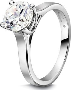 Jeff Cooper Solitaire Engagement Ring : This beautiful solitaire engagement ring setting by Jeff Cooper will perfectly show off your choice of a center diamond.