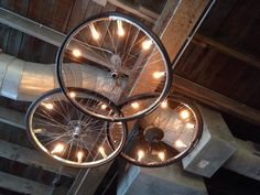 Bicycle wheel chandelier above our table. One made of paintbrushes nearby. :-D
