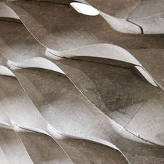 Stone surfaces from Lithos, carved stone, room divider, italian design