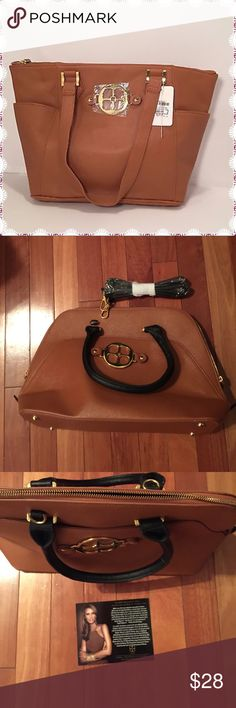 Beautiful IMAN Handbag Beautiful brown IMAN Handbag. NWOT ( 1st pboto is not the actual purse)  Extremely stylish. Comes with a shoulder strap. Shoulder strap & hand straps are black. IMAN Bags