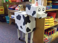 Cardboard cow I made for dramatic play farm. We even 'milked' him one day using a glove filled with water and a tiny hole poked into each finger
