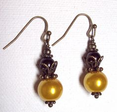 """Earrings Gold and Black  """"STEELERS""""  Glass Pearl  Antique Brass FREE SHIPPING. $5.95, via Etsy."""