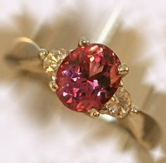 Trendy Diamond Rings : Pink Spinel and Diamond Ring  1.86 ct oval-cut spinel  flanked by brilliant-cu