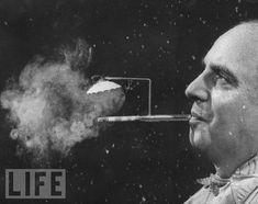 LIFE Magazine~Rainy Day Cigarette Holder,1954. President of Zeus Corp., Robert L. Stern, smoking a cigarette from his self-designed rainy day cigarette holder.Photo by ~Yale Joel~♛