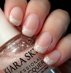 If you're tired of the old white french tip, you can try this colorless nail polish with bits of white pieces. This could then be your new attack on the classic trend.