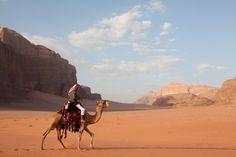 Camel and bedouin in Wadi Rum desert