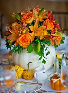 40 Awesome Fall Pumpkin Centerpieces: 40 Fall Pumpkin Centerpieces With wooden dining table and orange fall flower decor and white pumpkin ornament – Momtoob Thanksgiving Centerpieces, Table Centerpieces, Diy Thanksgiving, Centerpiece Ideas, Wedding Centerpieces, White Pumpkin Centerpieces, Autumn Centerpieces, Floral Centrepieces, White Pumpkins