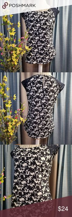 🌻🌺🌻NEW YORK & COMPANY NWOT FLORAL BLOUSE!! SIZE:small   BRAND:New York and Company   CONDITION:NWOT, no flaws    COLOR:navy blue and white  Has cute lace cap sleeves.   🌟POSH AMBASSADOR, BUY WITH CONFIDENCE!   🌟CHECK OUT MY OTHER ITEMS TO BUNDLE AND SAVE ON SHIPPING!   🌟OFFERS WELCOME!   🌟FAST SHIPPING! New York & Company Tops