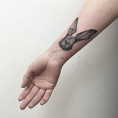 Geometric Bunny Head Tattoo - http://www.tattooideas1.org/placement/forearm/geometric-bunny-head-tattoo/
