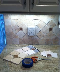Do you like my paper backsplash? Just don't get it wet! Scanned the tile (see front left on counter in the photo), printed them on paper, cut them out, & blue taped them to the wall to see if we liked the pattern. Backsplash Wallpaper, Tile Saw, Counter, Tile Floor, Texture, Printed, Pattern, Blue, Ideas