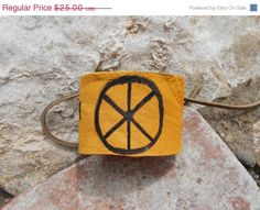 ON SALE Leather Cuff Bracelet with Hand by FaeMoonWolfDesigns, $21.25