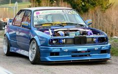 BMW E30 M3 blue widebody