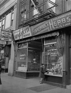 An Italian spaghetti house and a German health food store next to each other on 86th St. in New York, Jan. 22, 1942