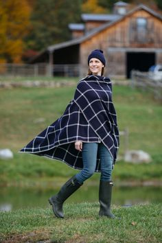 Take on the chilly fall weather by draping a poncho over your outfit: